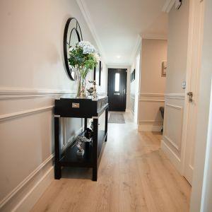 Beige wood floor in hallway